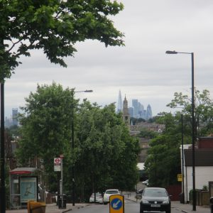 . . . there was a view and a half across South London to the City. A cluster of skyscrapers towered above the treeline on the misty horizon, like the ruins of an ancient Cambodian wat...